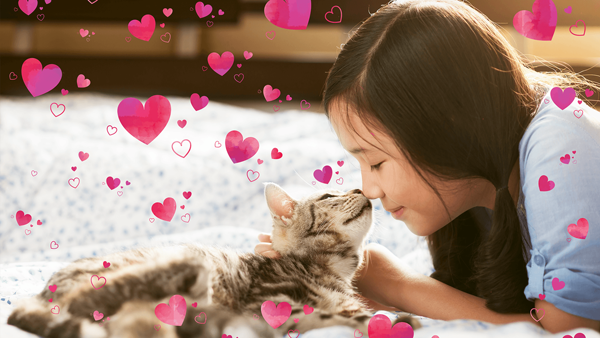 A girl feels comfortable with her nose touching the nose of a dog and hearts are flying all over the picture