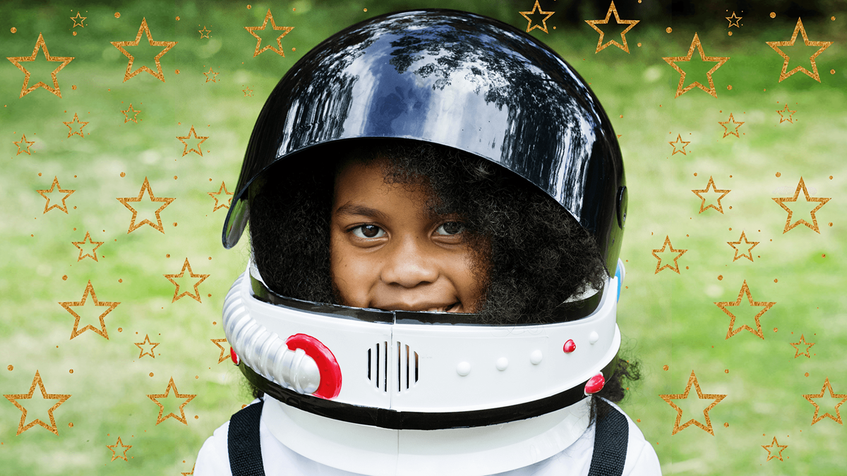 A girl with a helmet put on and a pattern of star fills the picture