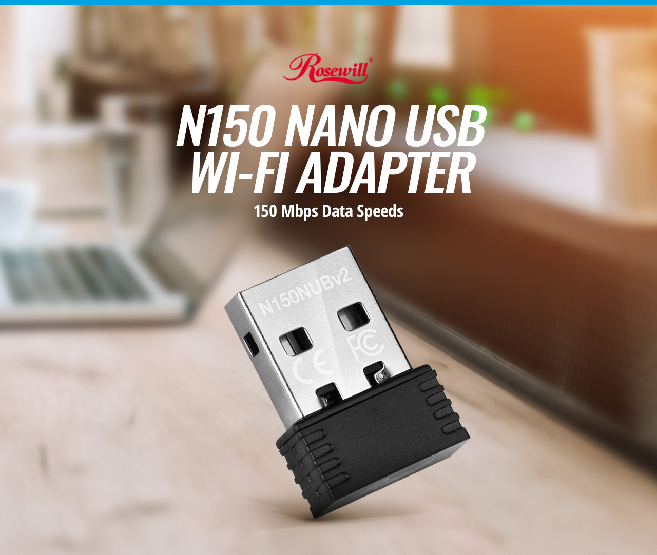 Rosewill RNX-N150NUBv2 NANO USB WI-FI ADAPTER 150 Megabits per second Data Speed tilted up to the right on a kitchen counter in front of a laptop