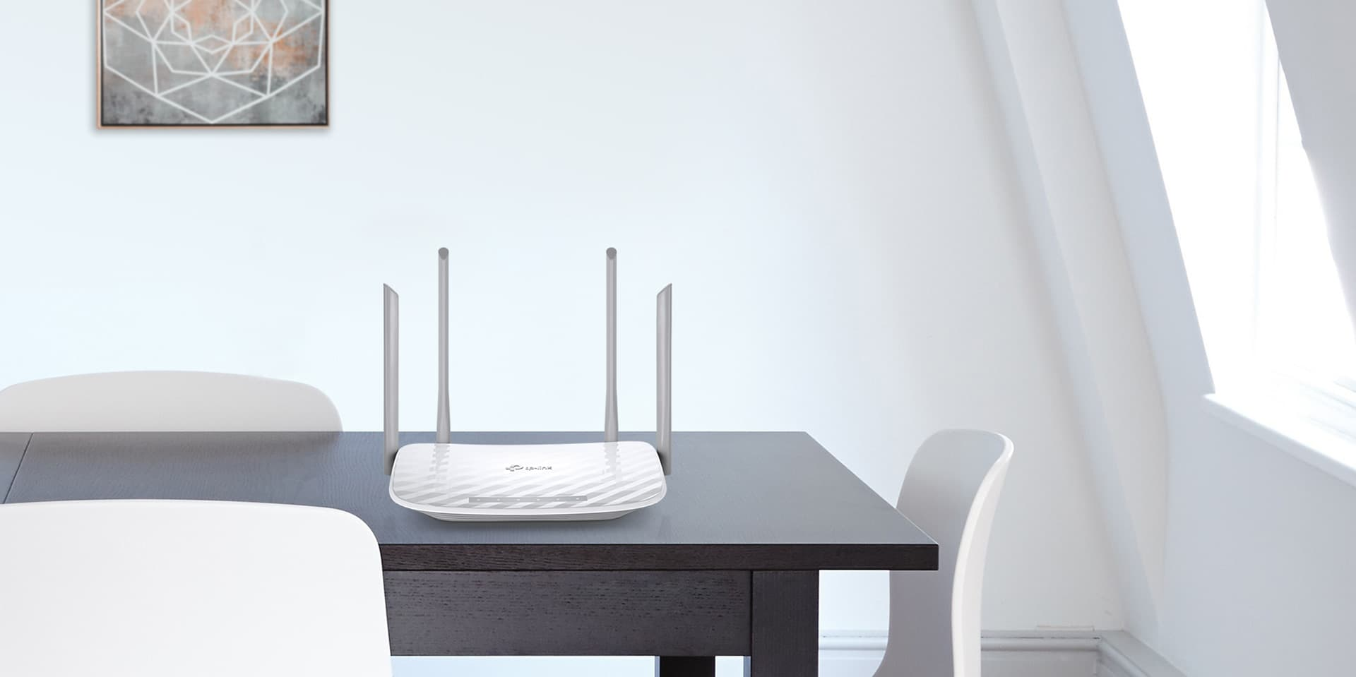 TP-LINK Archer C50 on a tabletop in a modern home setting