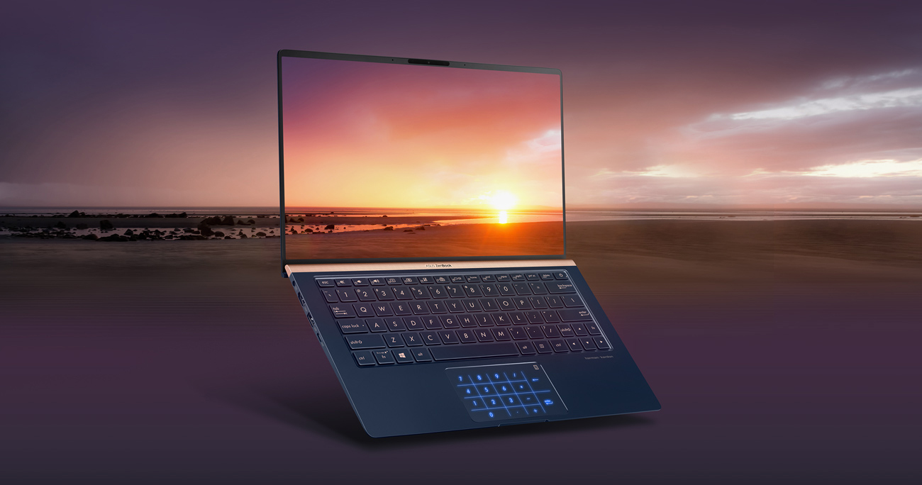 An opened laptop's display shows the bezel cause little distration from a scenery.