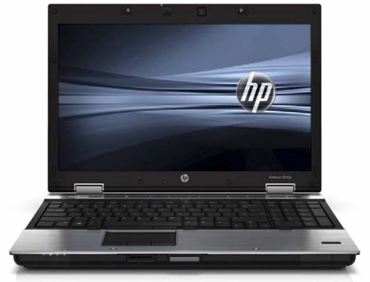 HP EliteBook 8540P laptop, open and facing forward with a black and gray graphic background with the HP logo
