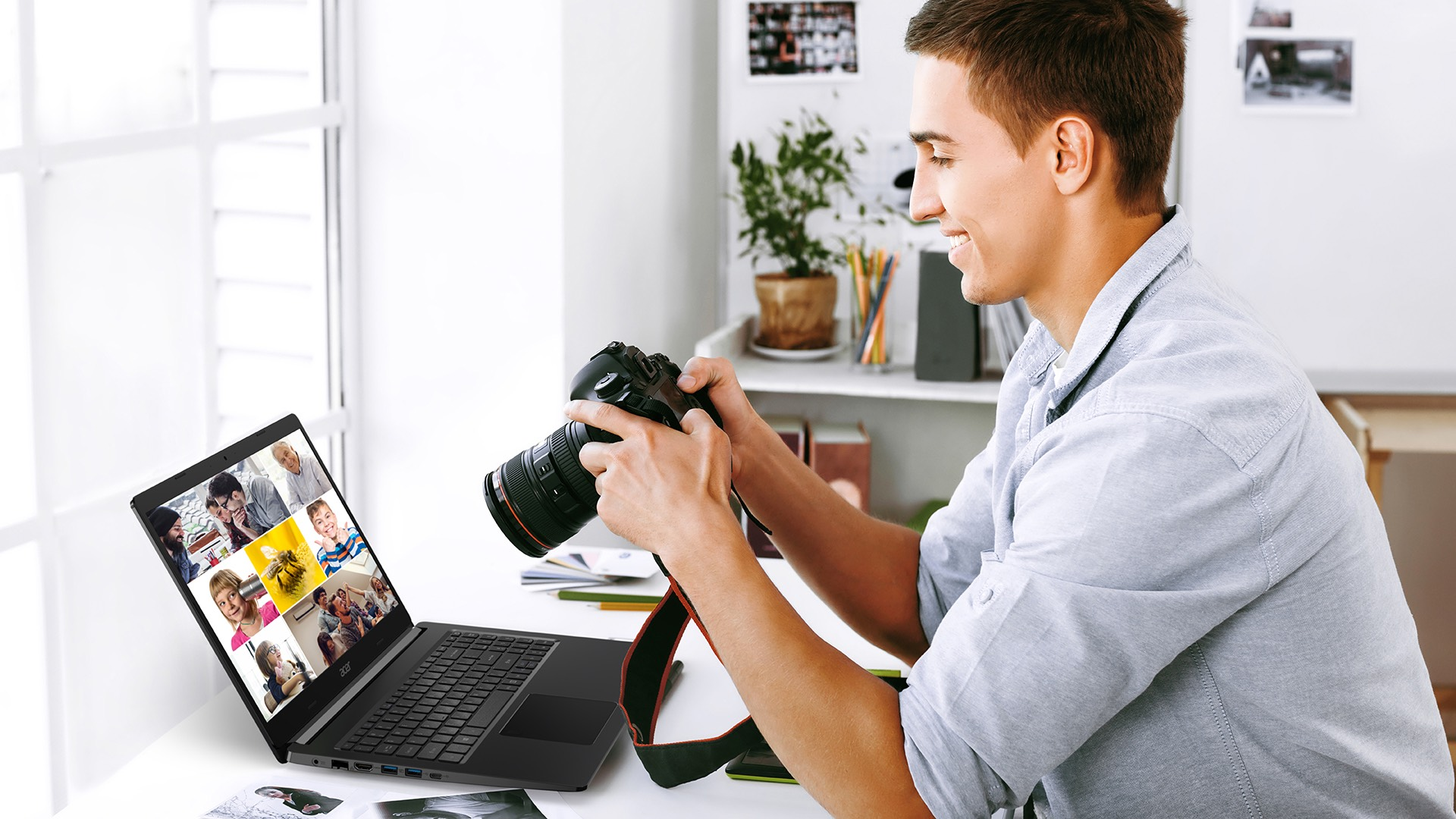 A man is taking photos. He focuses on the notebook display which shows some images.