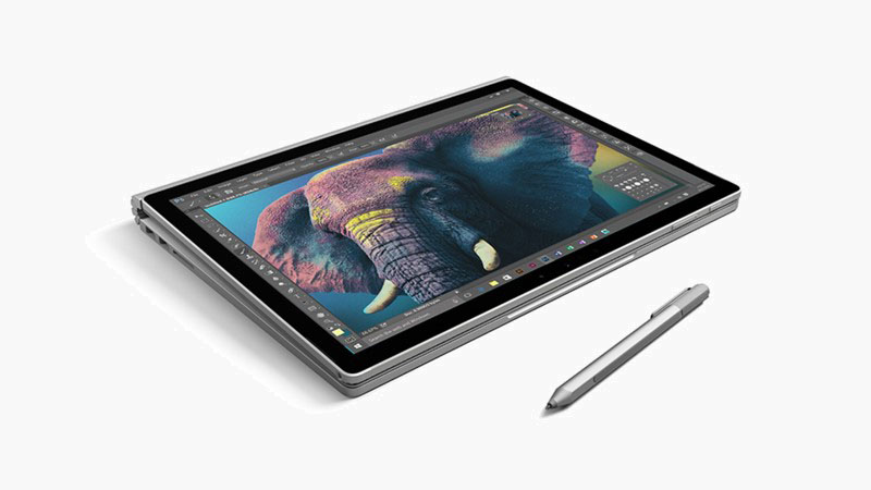 Surface Book in tablet mode beside a Surface Pen