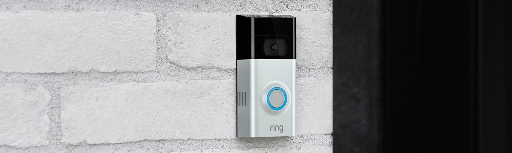 A Ring Video Doorbell mounted on a brick wall