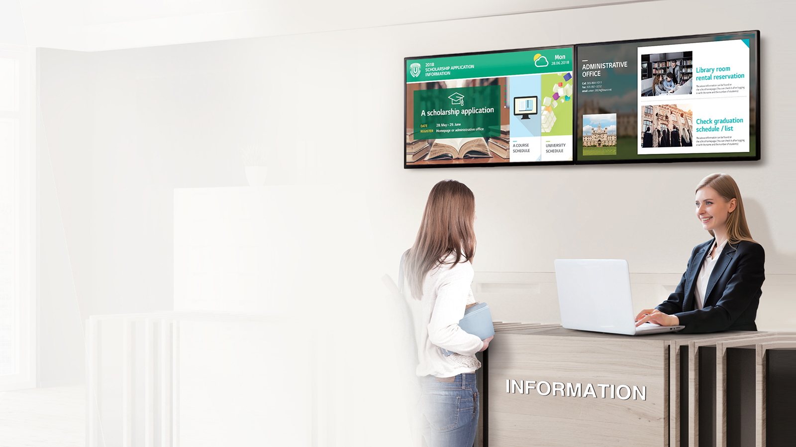 Two LG commercial displays mounted behind an information kiosks that two women are at