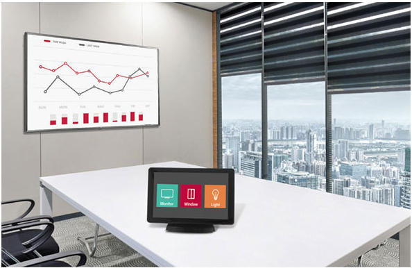 LG commercial display in an office's meeting room wall