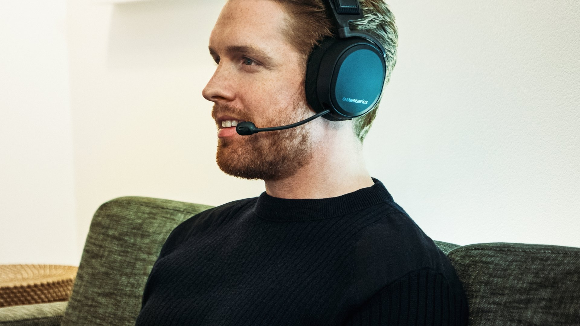 A man wearing the SteelSeries Arctis Pro headset looking to the left