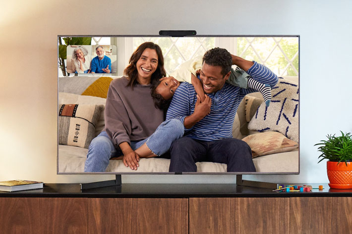 Portal TV moutned on a TV making video calls between one family and their grandparents
