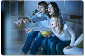 family enjoy theater experience at home
