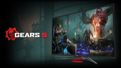 Front angle view of a gaming monitor, showing game scene of Gears 5