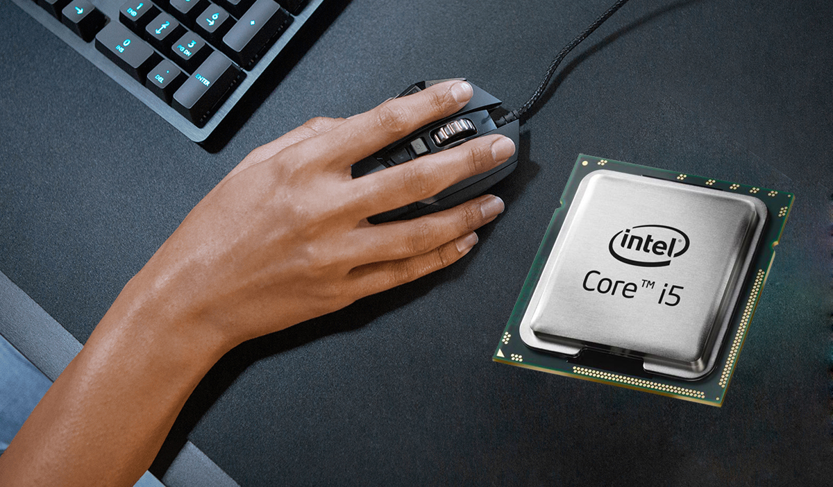 Intel Core i5 9th Gen 9600K processor is placed on a desktop with part of akeyboard and a hand holding a mouse next to it.