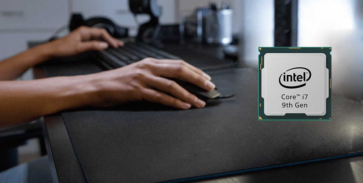 Intel Core i9 9th Gen 9700K processor is placed on a desktop with part of a keyboard and a hand holding a mouse next to it.