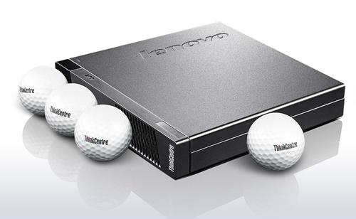 Four golf balls are surrounding around a desktop PC