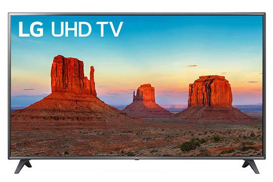 LG UHD TV facing forward with a desert plateau on screen