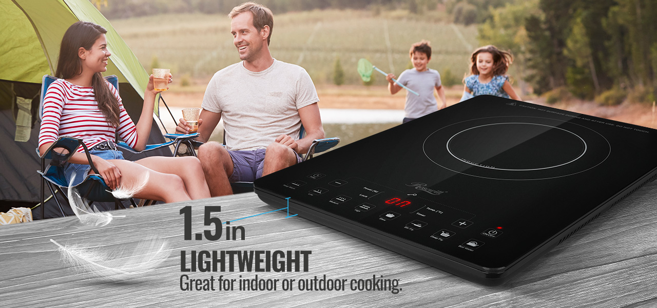 Rosewill Energy Efficient Induction Cooker on a Wooden Surface in Front of a Family of Four in Front of Their Tent Outdoors, The Parents Are Sitting, Talking and Drinking While the Kids Are Running in the Background, Playing. There is text that reads: 1.5 inches LIGHTWEIGHT - Great for indoor or outdoor cooking.