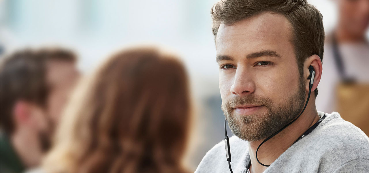 The Jabra Elite 65e worn by a man