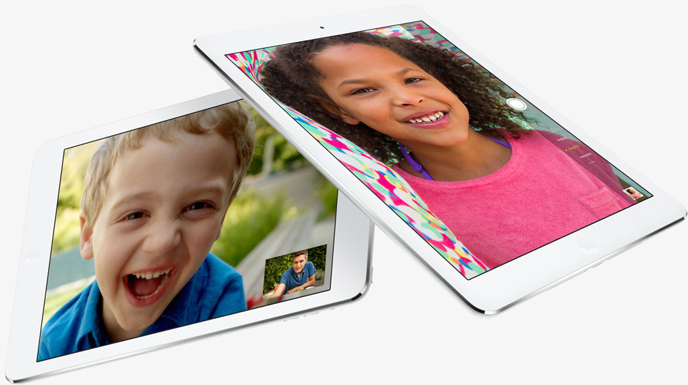 Two iPad Air, with one partially stacking over the other one. Screen of each iPad Air shows interface of video chat.