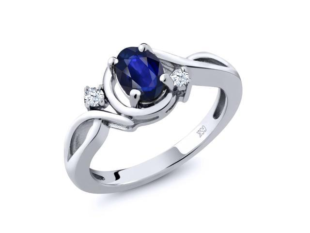 0.65 Ct Oval Blue Sapphire White Topaz 18K White Gold Ring