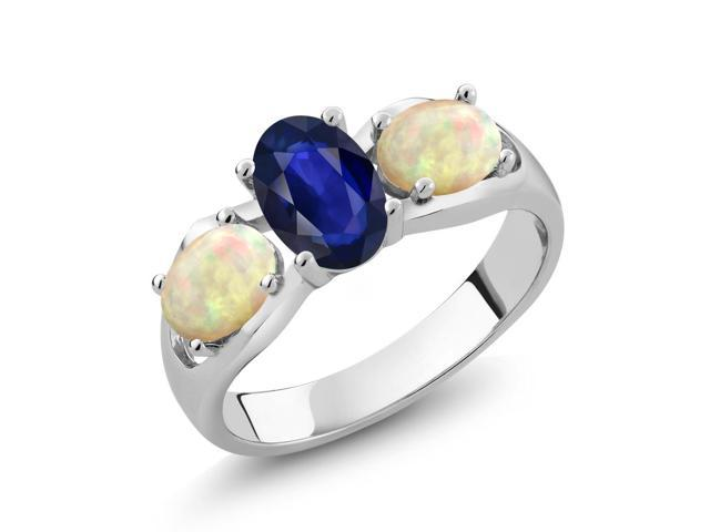 1.21 Ct Oval Blue Sapphire White Ethiopian Opal 14K White Gold 3-Stone Ring