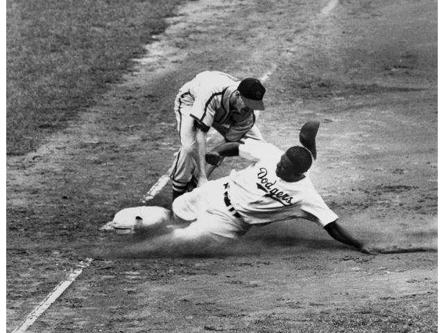 Jackie Robinson (1919-1972) Njohn Roosevelt Robinson Known As Jackie American Baseball Player As A Member Of The Brooklyn Dodgers Being Tagged Out At Third Base By Shortstop Marty Marion Of The St Lou