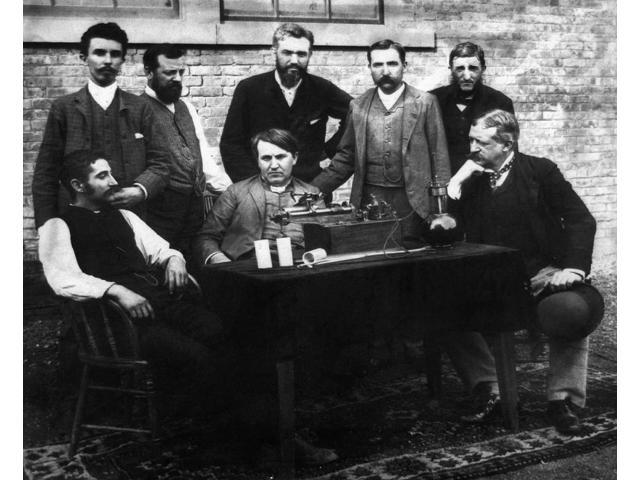 Thomas Edison (1847-1931) Namerican Inventor Photographed Seated In Center With His Staff Fred Ott At Left And Col George Gouraud At Right Standing (Left To Right) Are WKL Dickson Charles Batchelor A