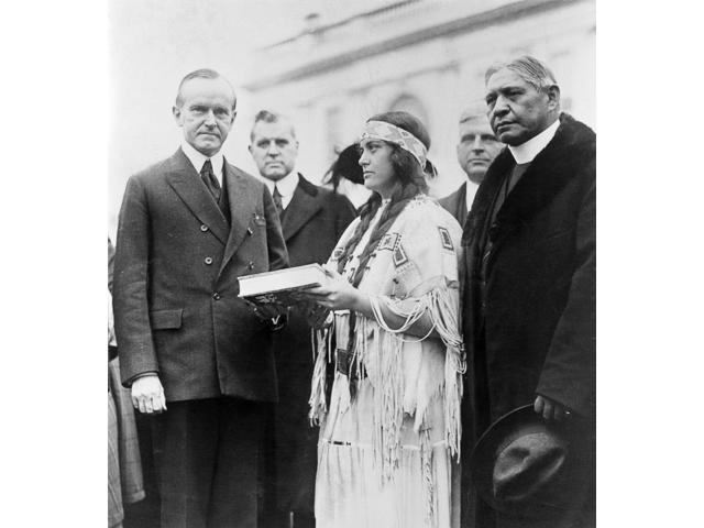 Calvin Coolidge (1872-1933) N30Th President Of The United States Coolidge Is Presented With A Copy Of The Red Man In The United States A Survey Of The Present Day American Indian By Ruth Muskrat A Che