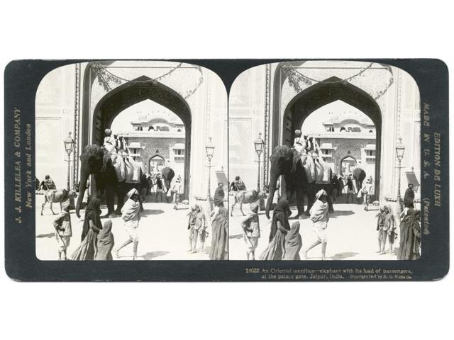 India Jaipur C1907 NAn Oriental Omnibus - Elephant With Its Load Of Passengers At The Palace Gate Jaipur India Stereograph C1907 Poster Print by  (18 x 24)