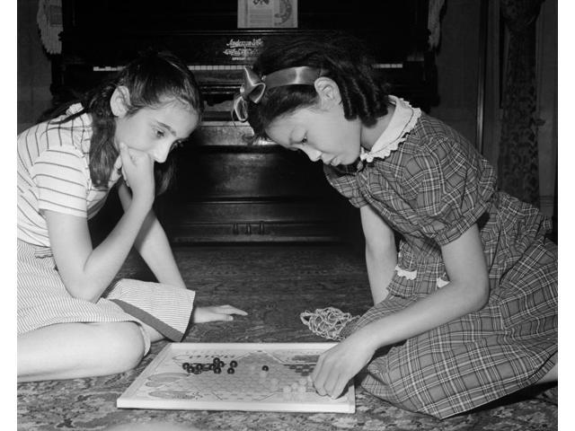 Chinese Checkers 1942 Na Chinese-American Girl Playing Chinese Checkers With Her Jewish Friend At Home In Flatbush Brooklyn New York Photograph By Marjory Collins 1942 Poster Print by  (18 x 24)