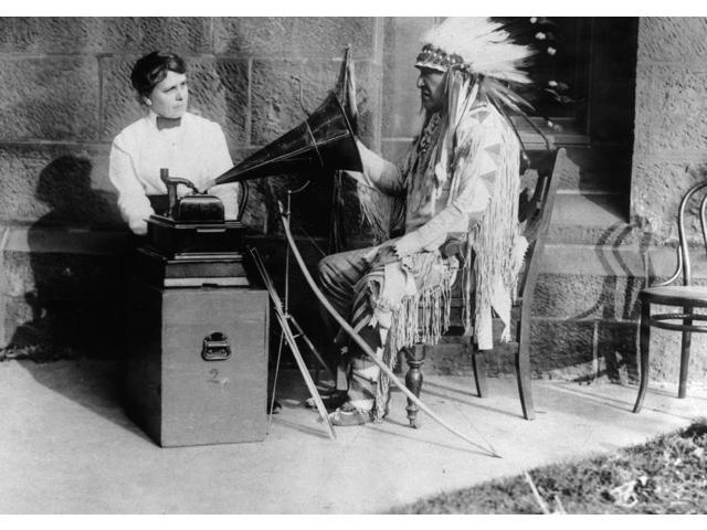 Blackfoot And Phonograph Nmountain Chief (Ninastoko) Chief Of The Blackfoot Native Americans Of Montana Listening To A Song On A Phonograph And Interpreting It In Sign Language To The Ethnologist Fran
