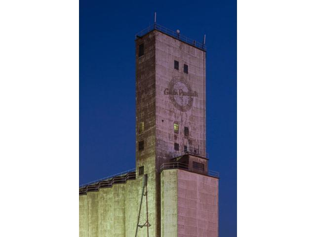 Low angle view of a grain elevator at dusk Dodge City Ford County Kansas USA Poster Print (18 x 24)