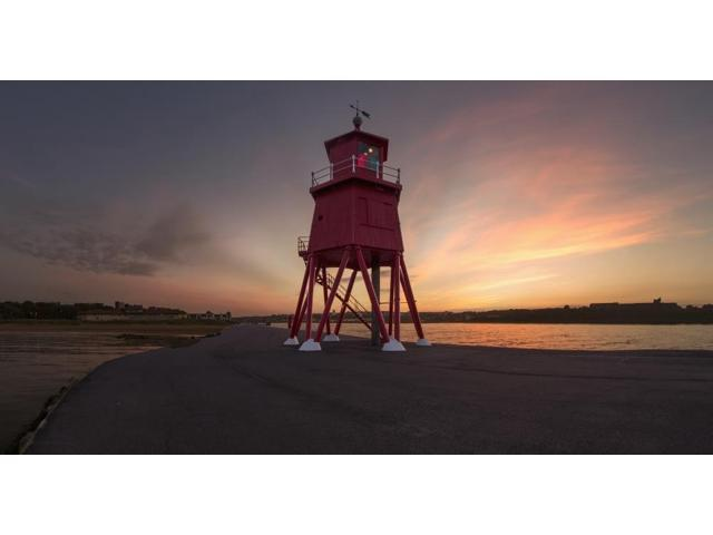 Herd Groyne Lighthouse on the waters edge of the River Tyne at sunset South Shields Tyne and Wear England Poster Print (21 x 11)