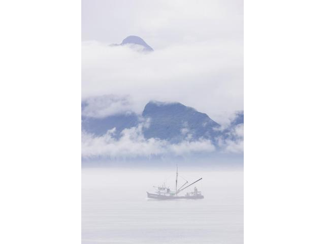 Commercial fishing boat Silver salmon fishing outside of Valdez small boat harbor with misty clouds and mountains in background Prince William Sound Southcentral Alaska USA Poster Print (12 x 19)