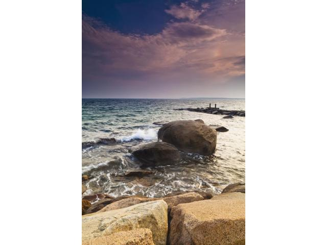 Glowing pink clouds at sunset and rocks along the coast Falmouth Massachusetts United States of America Poster Print (12 x 18)