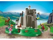 Rocke Climbers With Mountain Animals