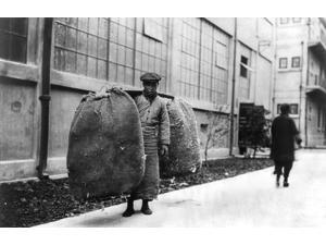 China Shanghai 1924 Na Chinese Worker Carrying 200 Pounds Of Cotton Through The Streets Of Shanghai China Photograph 1924 Poster Print by  (18 x 24)