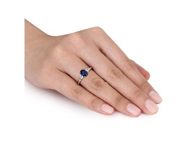 Amour 10k White Gold 2 1/3ct TGW Created Blue and White Sapphire Three Stone Ring