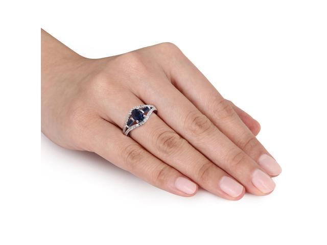 Amour Sterling Silver 1 5/8ct TGW Created Blue Sapphire and 1/10ct TDW Diamond Three Stone Ring (G-H, I2-I3)