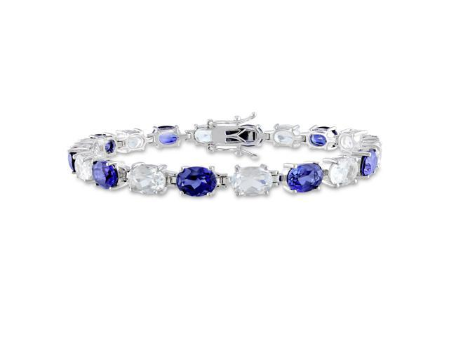 Amour Sterling Silver 21 3/4ct TGW Created Blue Sapphire and White Topaz Tennis Bracelet (7.25in)