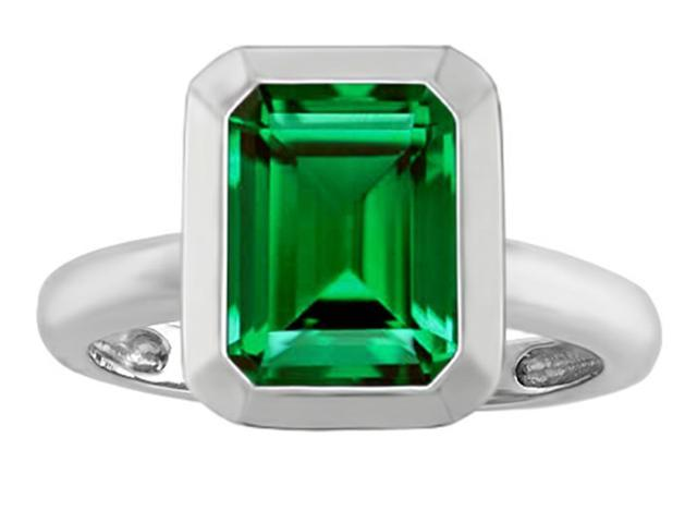 Star K 9x7mm Emerald Cut Octagon Solitaire Ring with Simulated Emerald in Sterling Silver Size 6