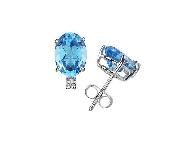 9X7mm Oval Blue Topaz and Diamond Stud Earrings in 14K White Gold
