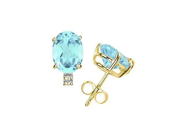 12X10mm Oval Aquamarine and Diamond Stud Earrings in 14K Yellow Gold
