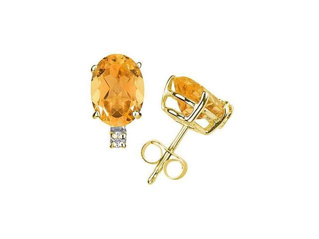 8X6mm Oval Citrine and Diamond Stud Earrings in 14K Yellow Gold