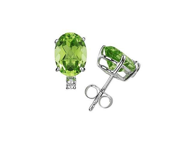 7X5mm Oval Peridot and Diamond Stud Earrings in 14K White Gold