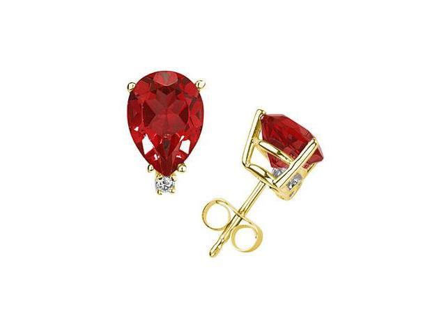 7X5mm Pear Ruby and Diamond Stud Earrings in 14K Yellow Gold