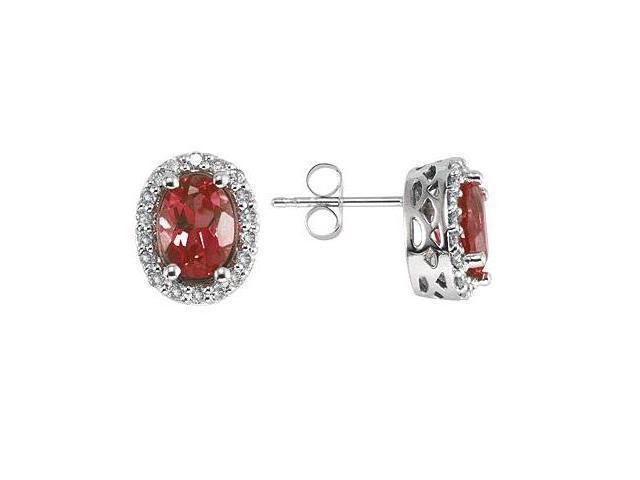 Oval Garnet and Diamond Earrings in 14K White Gold