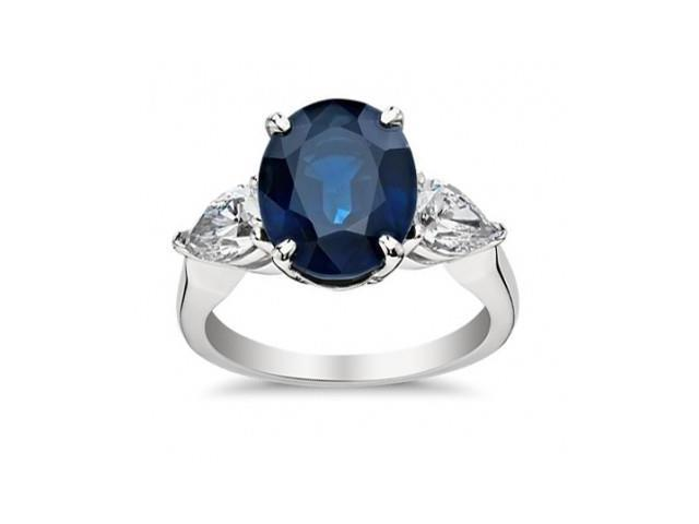 9.33 ct Oval Shape Sapphire With Pear Shape Diamond Anniversary Ring in 14 kt White Gold