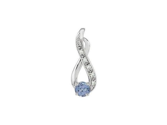 14 Karat White Gold Tanzanite & Diamond Pendant with a chain