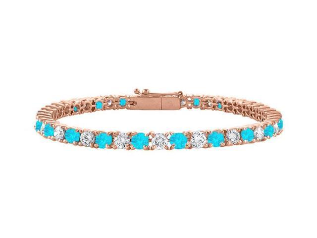 Created Blue Topaz and Cubic Zirconia Tennis Bracelet in 14K Rose Gold Vermeil. 2CT. TGW. 7 Inch