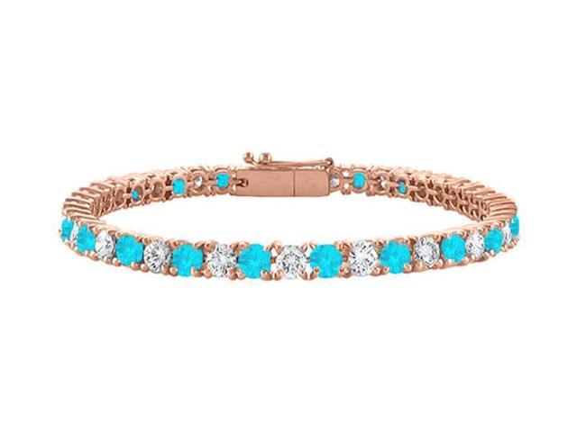 Cubic Zirconia and Created Blue Topaz Tennis Bracelet in 14K Rose Gold Vermeil. 5CT. TGW. 7 Inch